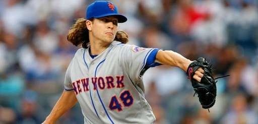 Jacob deGrom of the  Mets pitches against the Yankees
