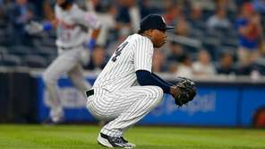 Aroldis Chapman of the Yankees reacts after surrendering