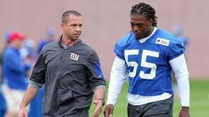 Giants linebacker J.T. Thomas works with strength and conditioning