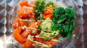 A salmon poké bowl at Kai Poké in