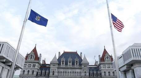 Flags are lowered to half-staff at the Empire
