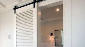 Sliding barn doors save space and offer an