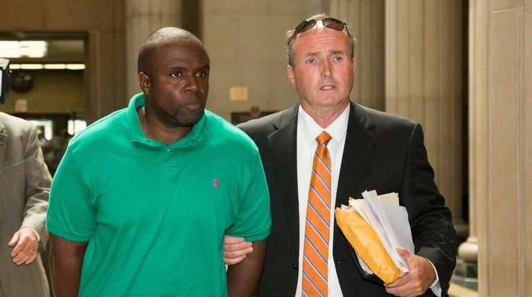 Nassau County probation officer Andy Jean-Louis, 46, of