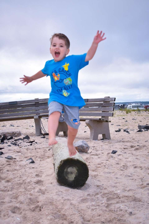 Lucas having fun at Hampton Bays Beach 8/2017