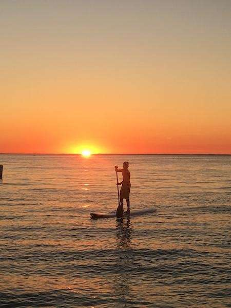 Alec paddle boarding at Long Beach on July