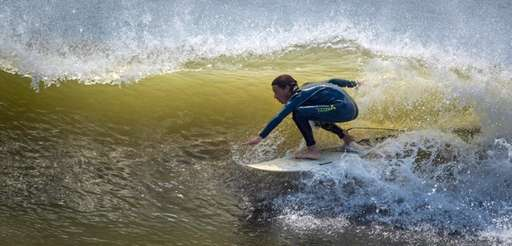 A surfer rides the waves at Long Beach