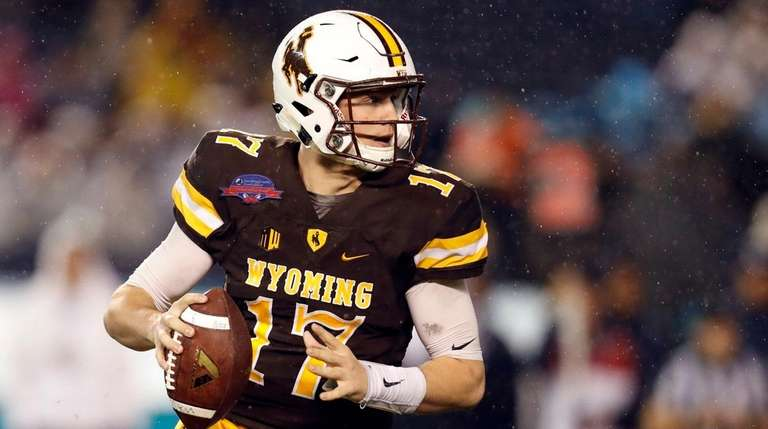 Wyoming quarterback Josh Allen looks to throw the