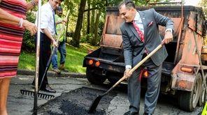Oyster Bay Town Supervisor Joseph Saladino helps shovel