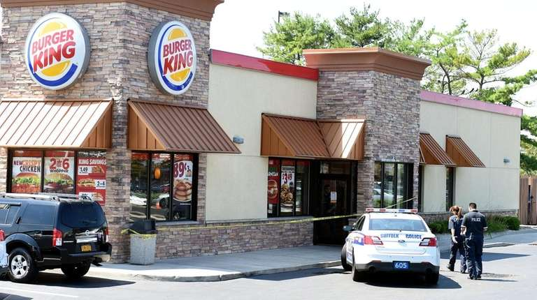 Suffolk County police investigate an armed robbery of