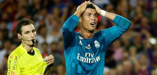 Real Madrid's Cristiano Ronaldo, right, reacts after Referee