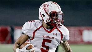 East Islip running back Justin Taveras runs for