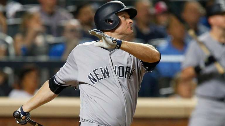 Chase Headley of the Yankees follows through on