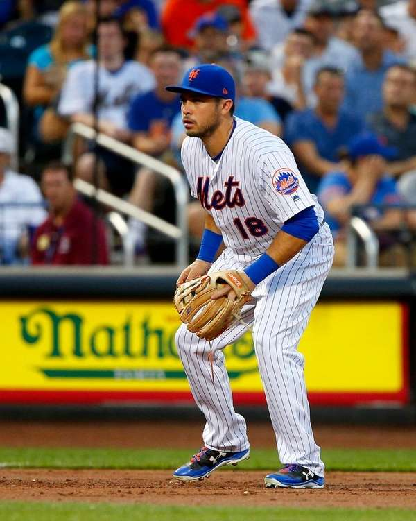 Travis d'Arnaud is positioned at third base during