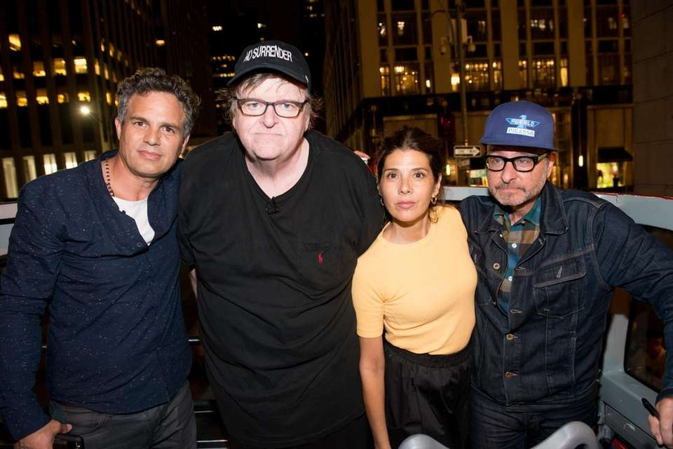 From left, Mark Ruffalo, Michael Moore, Marisa Tomei