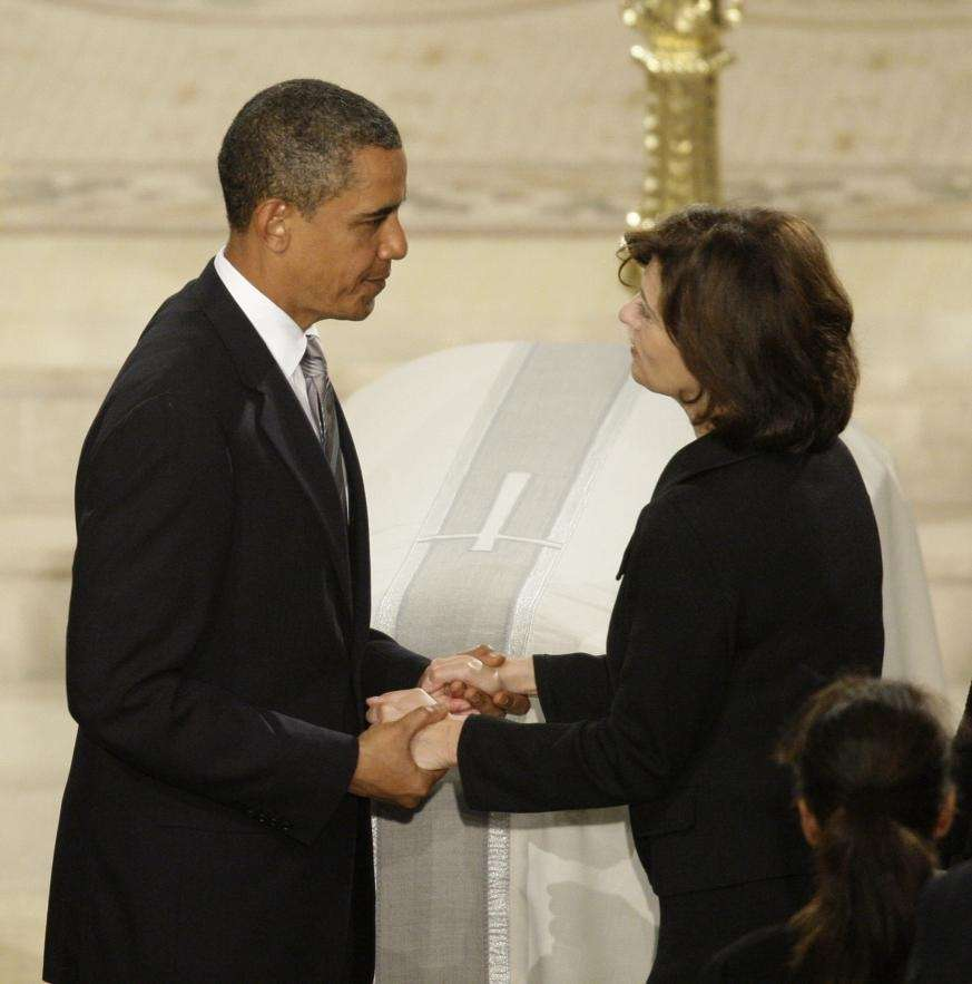 President Barack Obama greets widow Victoria Kennedy during