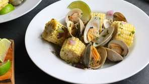 Littleneck clams are steamed with corn in lime