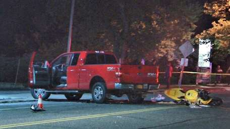 Suffolk County police respond to a crash on
