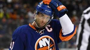 Islanders center John Tavares looks on against the