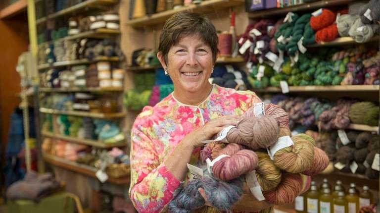 Peggie Ehlers holds a handful of wool products