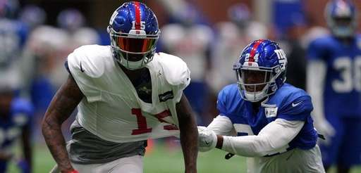 Giants cornerback Eli Apple grabs a handful of
