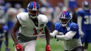 Giants cornerback Eli Apple grabs a handful of