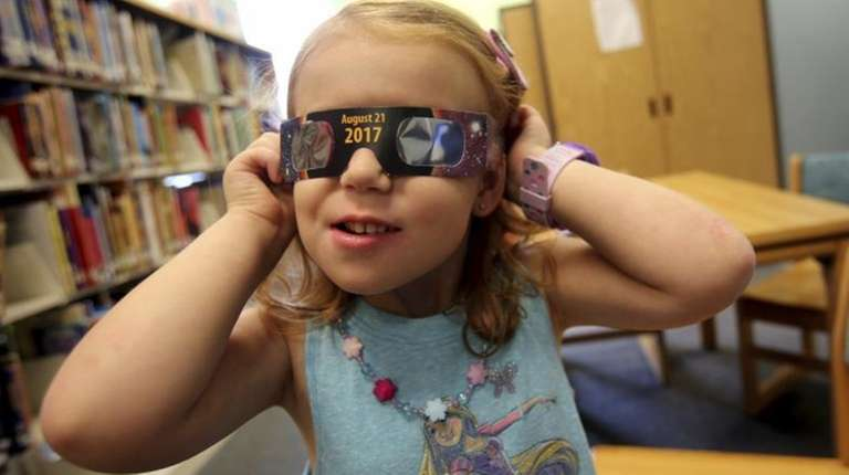 Emmalyn Johnson, 3, tries on her free pair