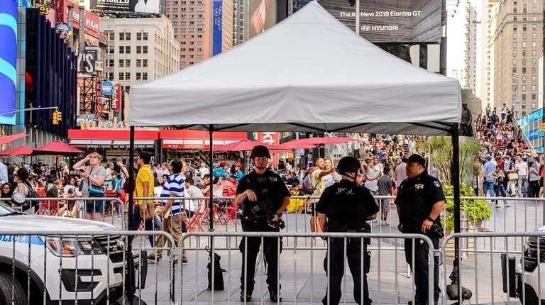 Heavily armed NYPD counterterrorism officers keep watch over