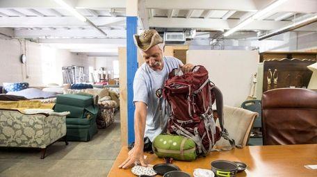 To prepare for his three-week trek, Rogers loads