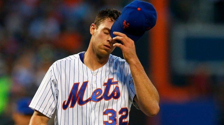 Steven Matz of the Mets walks to the