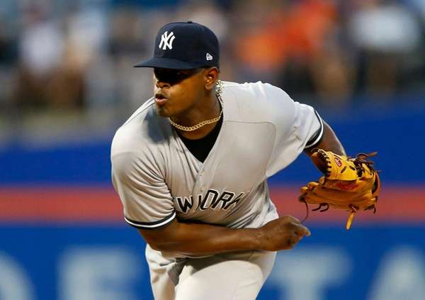 Luis Severino of theYankees pitches against theMets at