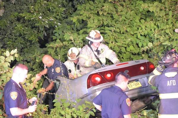 Suffolk County police and firefighters respond to an