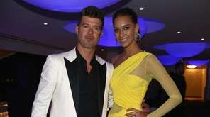 Robin Thicke and April Love Geary attend the