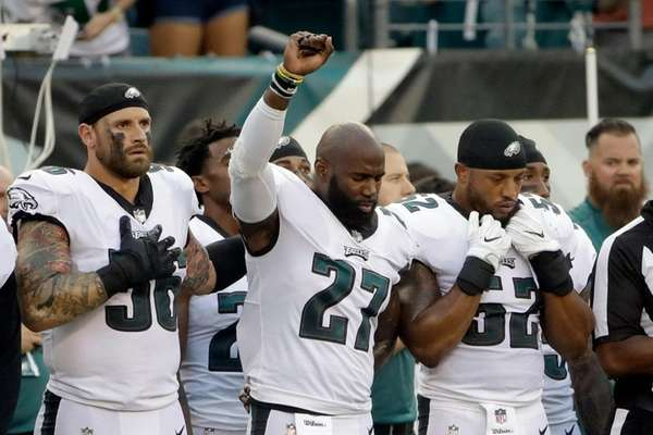 Eagles' Malcolm Jenkins raises his fist during the