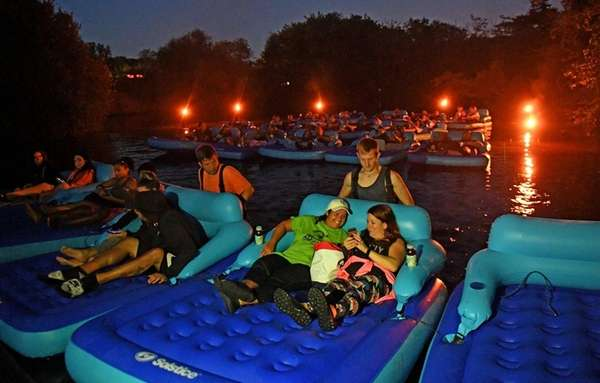 People board inflatable rafts to watch
