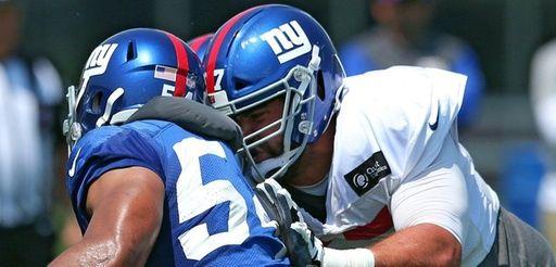 Giants guard Justin Pughblocks defensive end Olivier Vernon