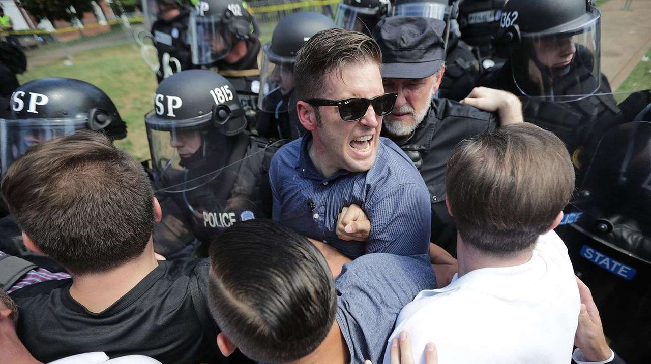 White nationalist Richard Spencer, center, and his supporters