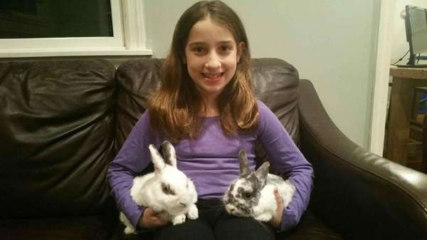Kidsday reporter Amaya Cigliano with her rabbits, Alfie,