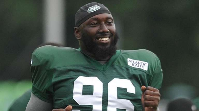Jets' Muhammad Wilkerson stretches during training camp at the