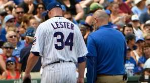 Cubs starting pitcher Jon Lester leaves the game during