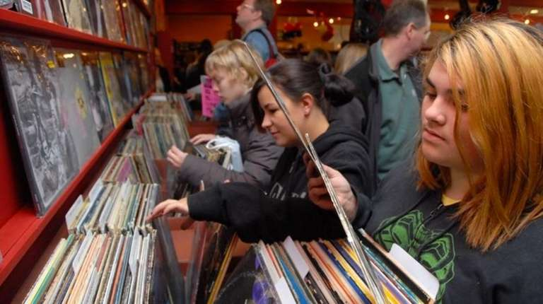 Customers sort through records at Looney Tunes in