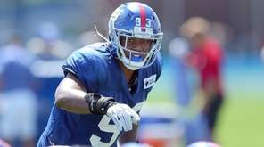 Giants linebacker B.J. Goodson signals to the defense during