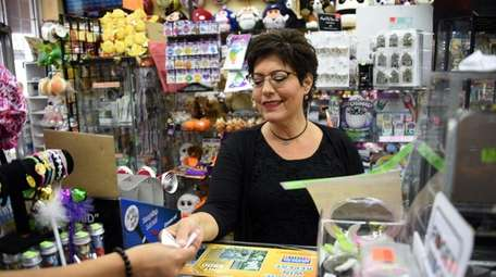 Suzanne Feynman of Brentwood buys Powerball tickets at