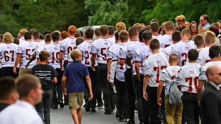Sachem Football players, friends and loved ones gather