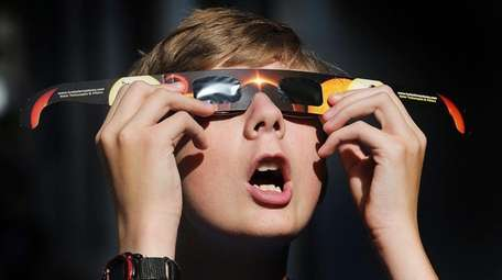 Colton Hammer tries out his new eclipse glasses