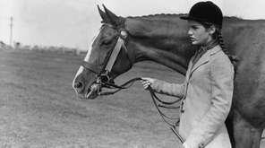 Jackie Kennedy poses with her mare, Danseuse.