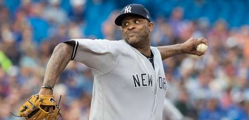 Yankees pitcher CC Sabathia throws against the Blue Jays in