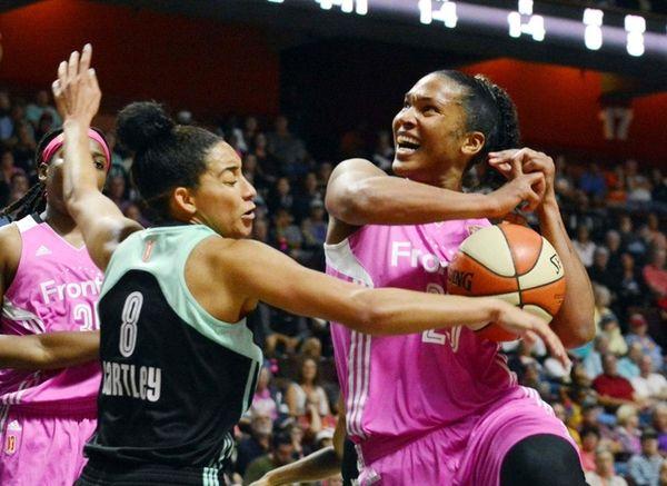 Connecticut Sun's Alyssa Thomas, right, loses the ball