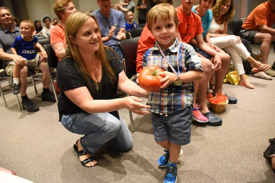 Wyatt DePace, 3, of Albertson receives his award