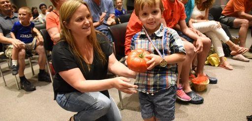 Wyatt DePace, 3, of Albertson receives his award