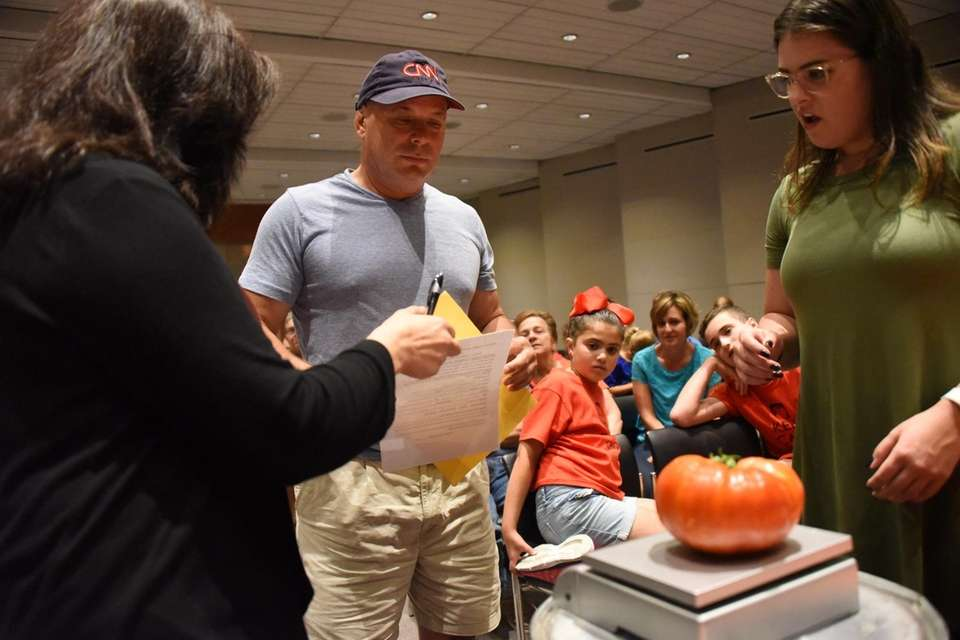 Al Tiranno of Smithtown has his tomato weighed